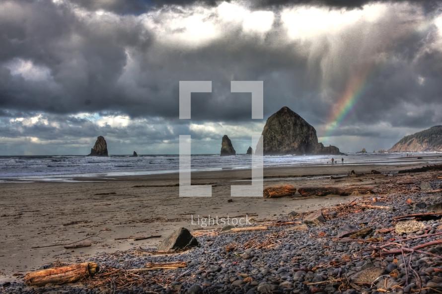 rocks and rainbow on a rocky coast