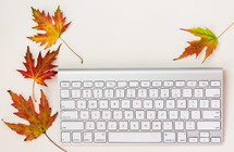 computer keyboard and fall leaves