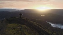 Cross on a hill at sunrise
