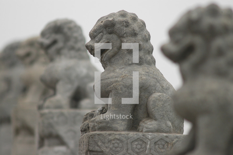 Carved Stone Lions on a bridge, symbol of royalty