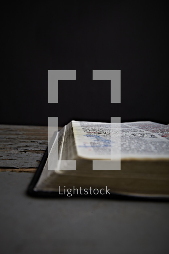 An open Bible laying on the table