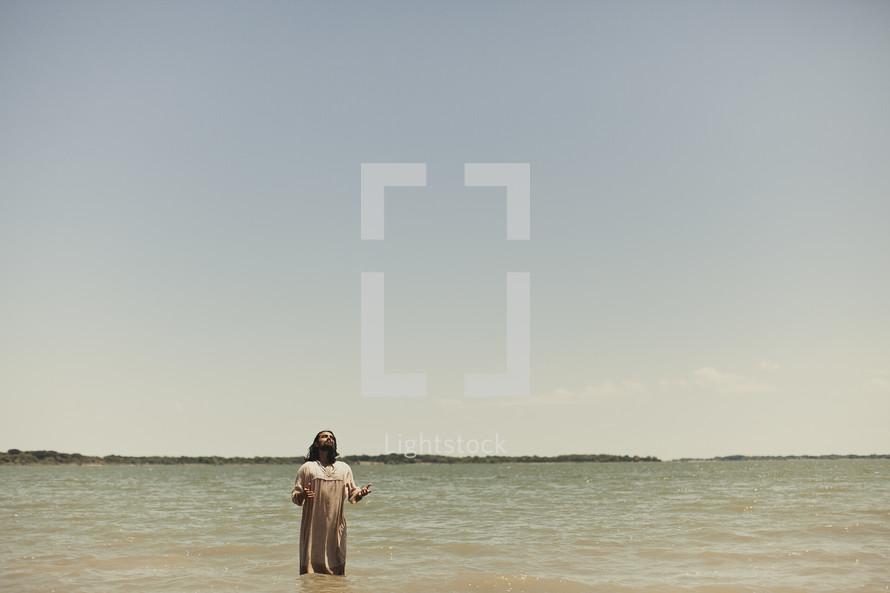 Jesus praying in the water before baptism