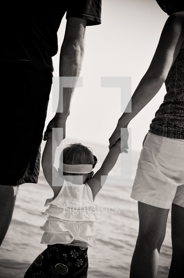 Family with baby girl on beach