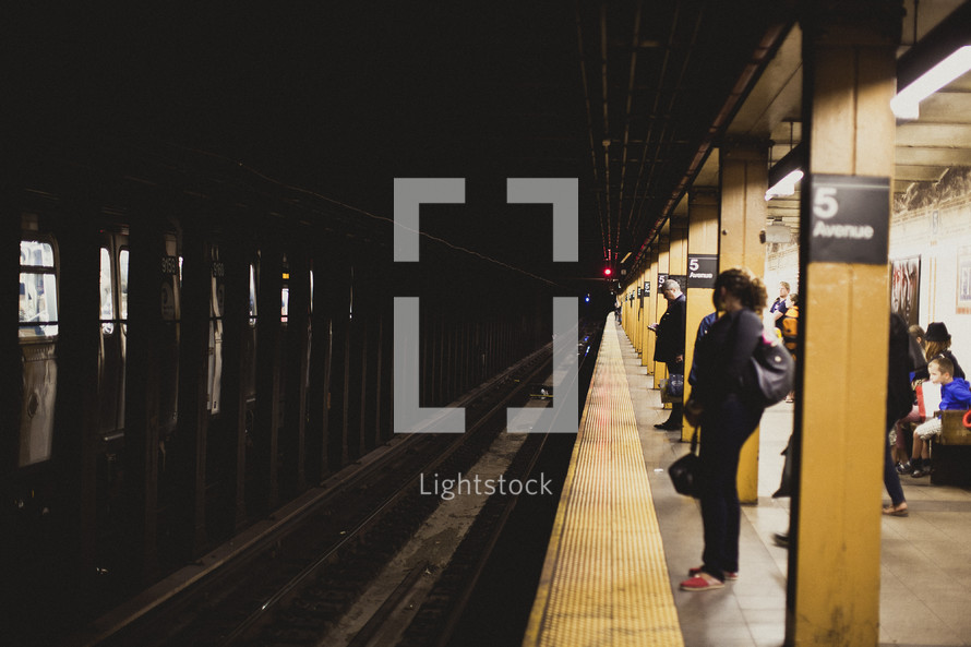 A woman waits for the subway in New York City