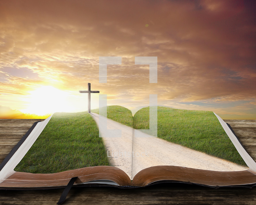 road leading to the cross on an open bible at photo by