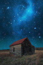 night sky over an old barn