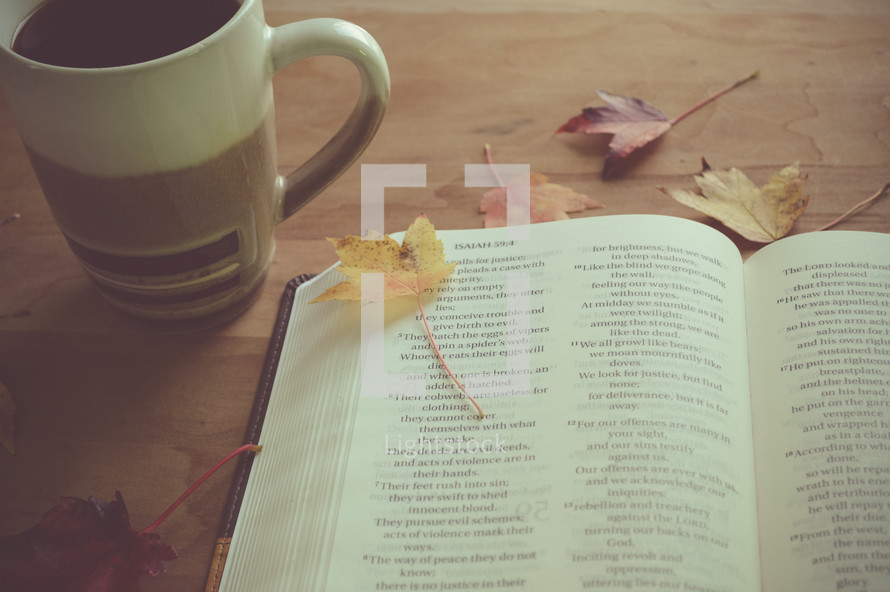 open Bible, coffee cup and fall leaves