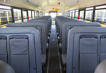 rows of seats in a school bus