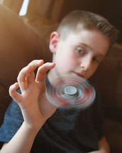 a boy with a fidget spinner
