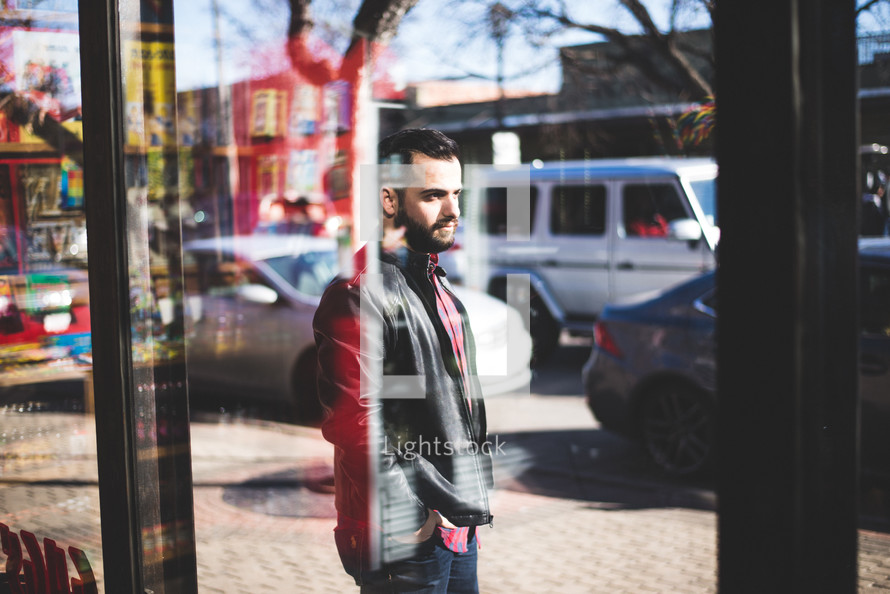 a man walking in front of a store window