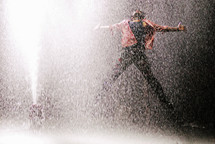 a man being sprayed with water