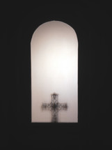 cross with an arched window