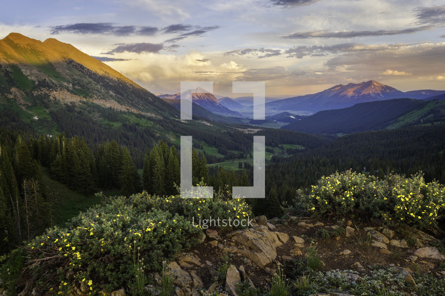 A beautiful sunset on the mountainside overlooking Mt Crested Butte on a wildflower summer day