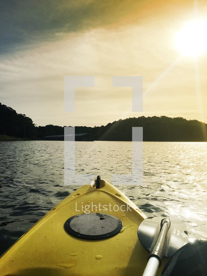 a kayak on the lake at sunrise.