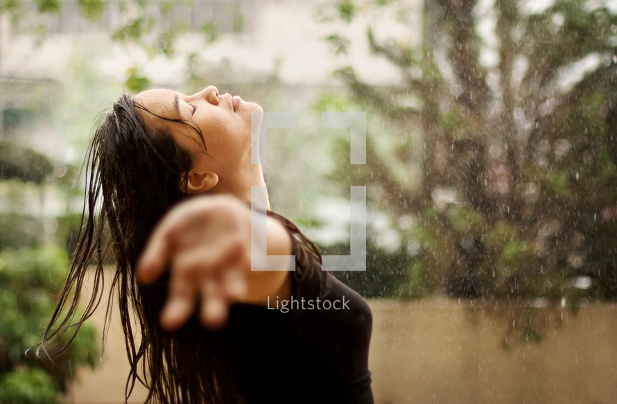 a woman enjoying the rain