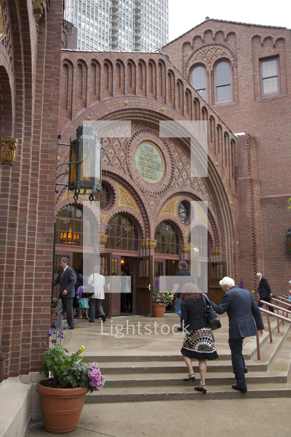 people entering a church
