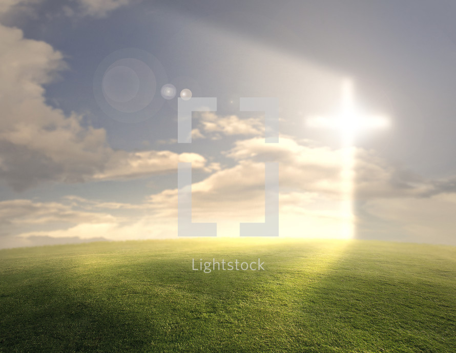 A large grassy field with a bright glowing cross on the horizon.