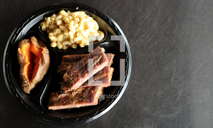A meal on a disposable plate.