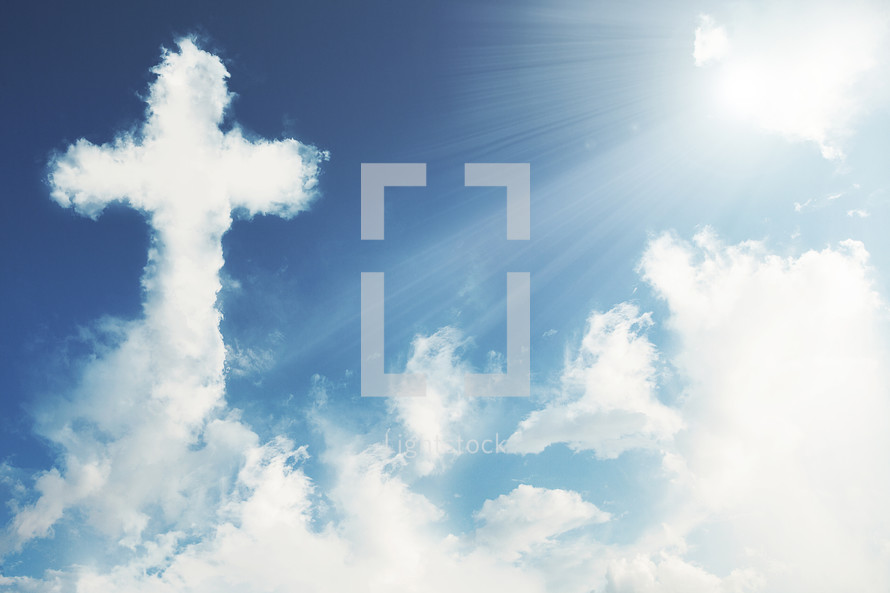 A cross made out of clouds in the sky with sun rays.