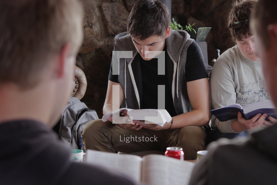 young men at a Bible study reading Bibles
