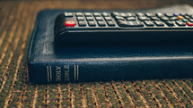 remote control on a Bible