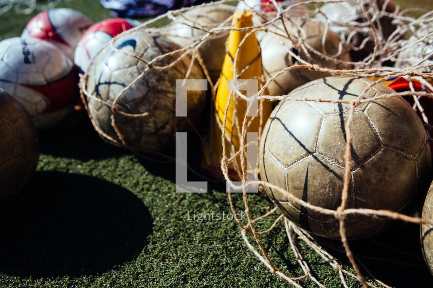 soccer balls in a bag