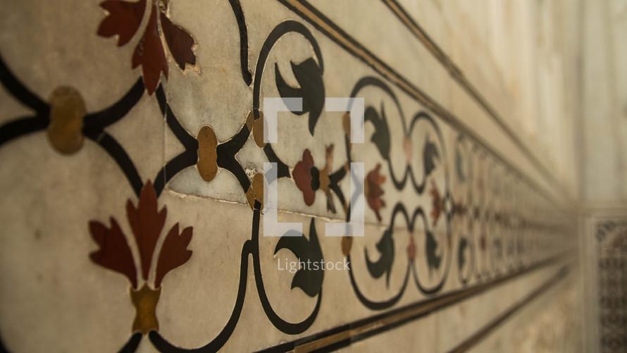 ornate scroll tile work in India