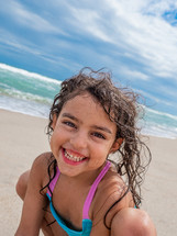 smiling kid on a beach