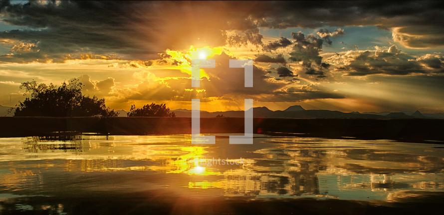 sunburst over a lake