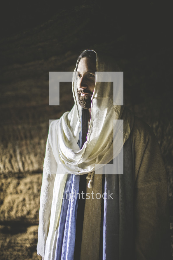 face of Jesus standing in a tomb