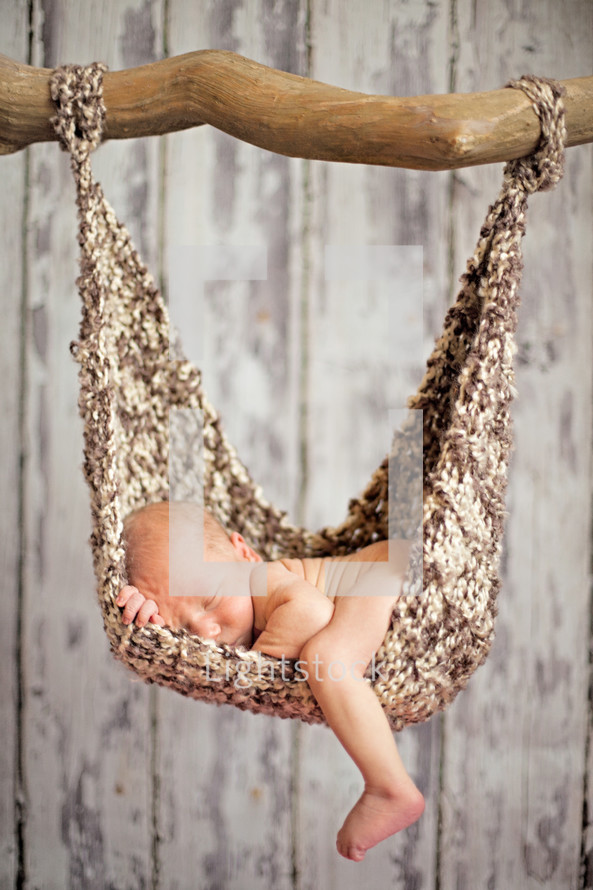 Infant lying in hammock