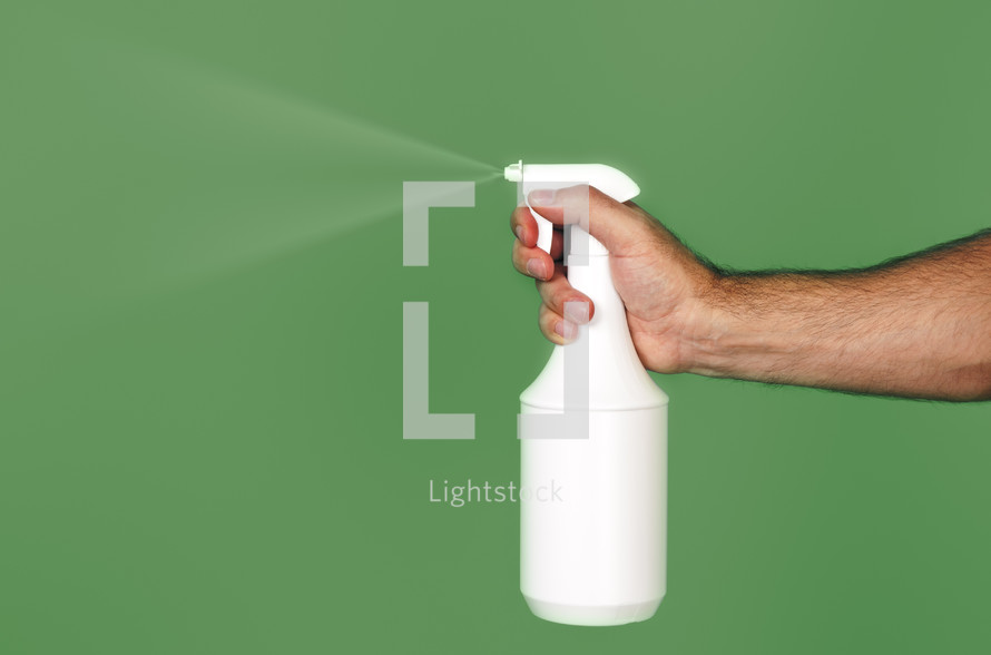 spraying a spray bottle