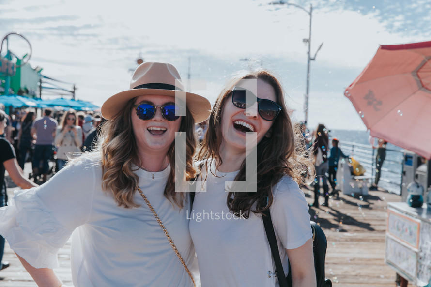 laughing friends on a pier
