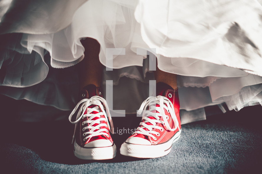 sneakers under a wedding gown