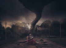 woman reading a Bible and tornado