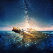 stars in the sky and a message in a bottle lost at sea