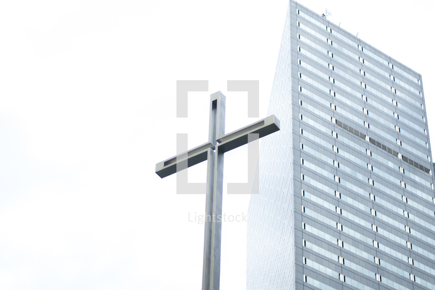 cross and tall building