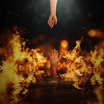 Jesus's hand and a hand reaching out of fire