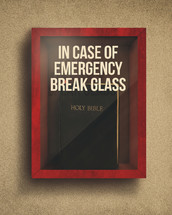Holy Bible in an emergency glass box.