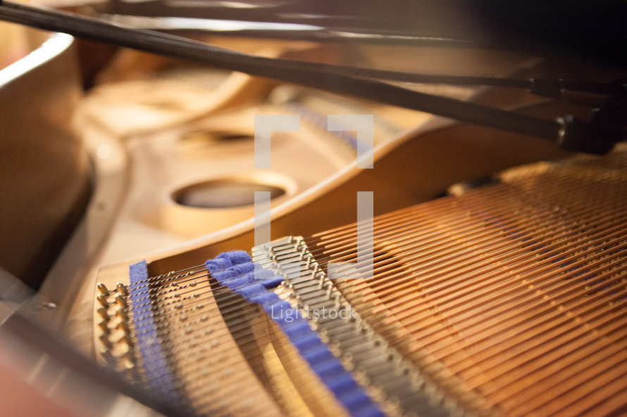Strings inside of a grand piano
