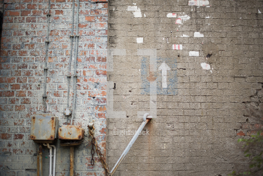 Brick walls with an arrow pointing up.