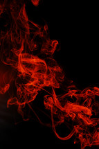 red smoke in darkness