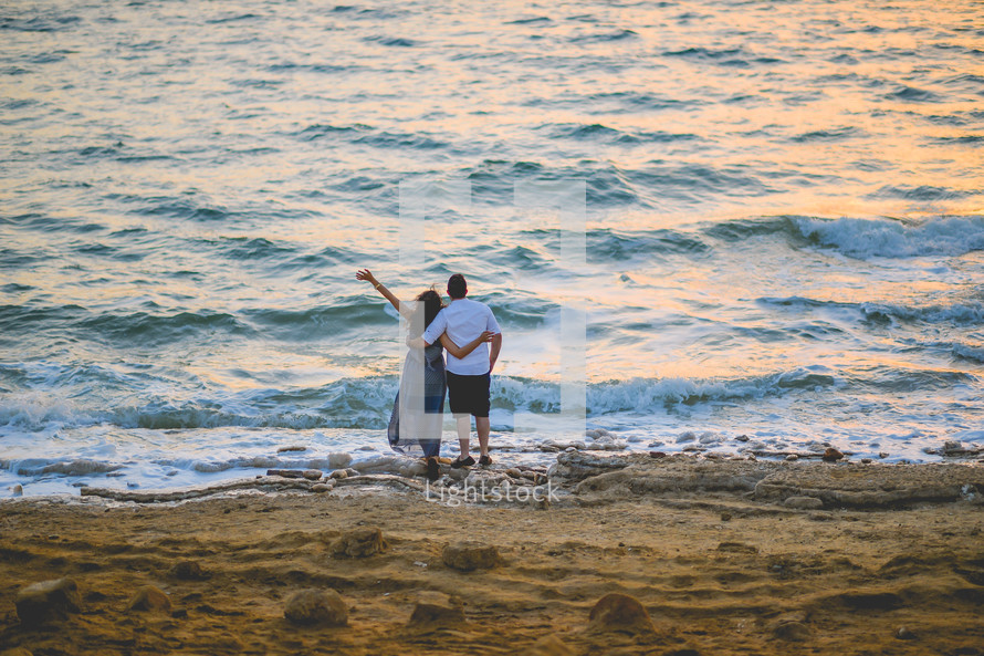 couple standing together on a beach
