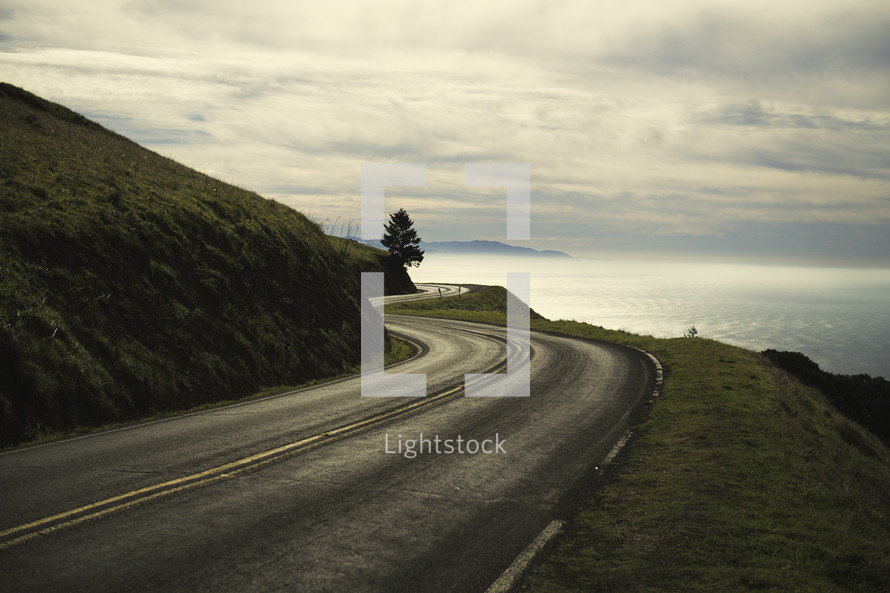 Winding Road On A Hill Near The Ocean.