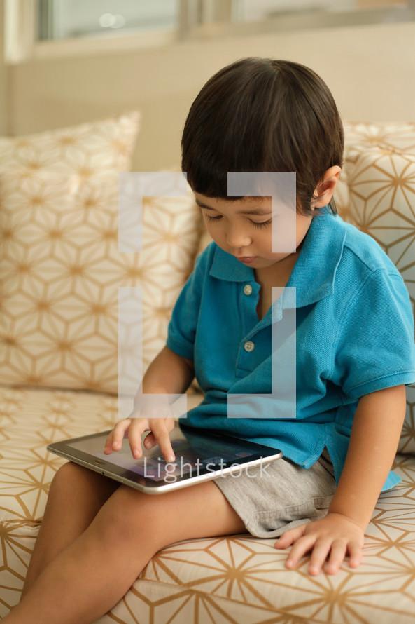toddler boy using an iPad