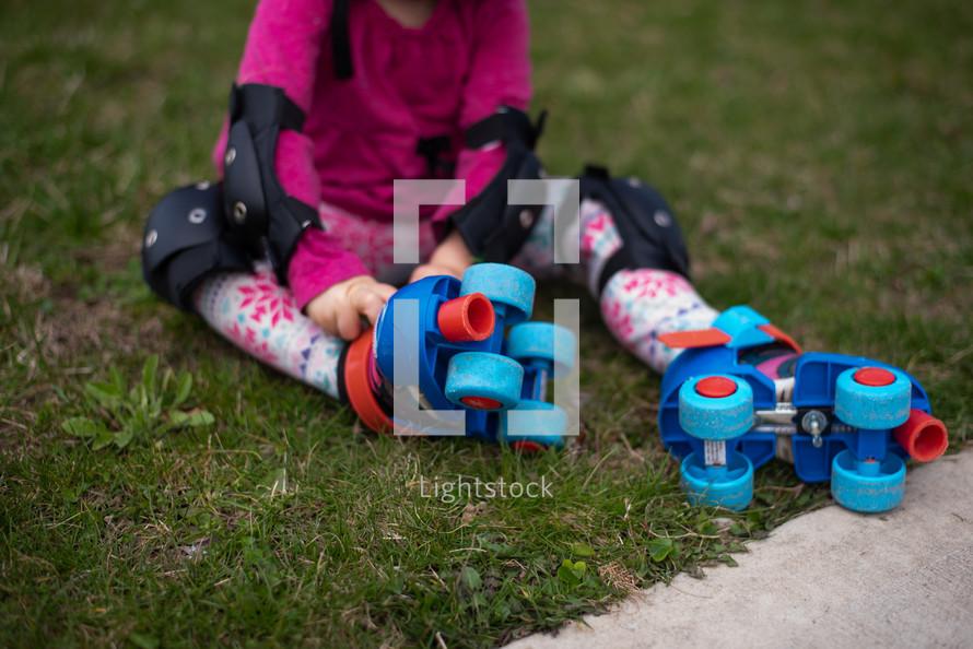 child wearing roller skates