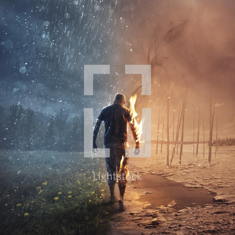 A man walks through burning fire and refreshing rain.