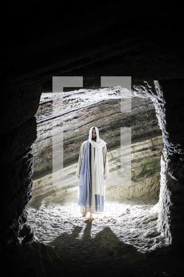 Jesus standing at the entrance of a tomb