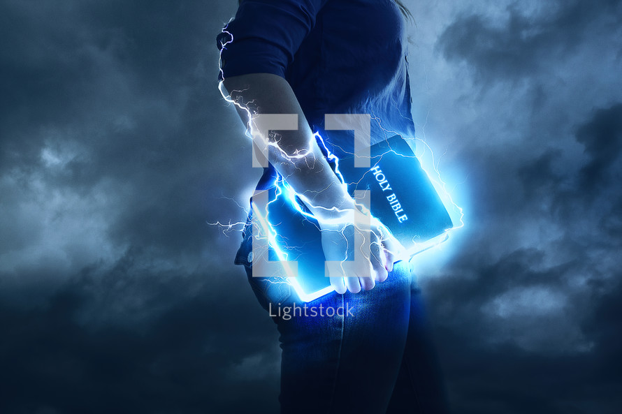 man holding an electrified Bible