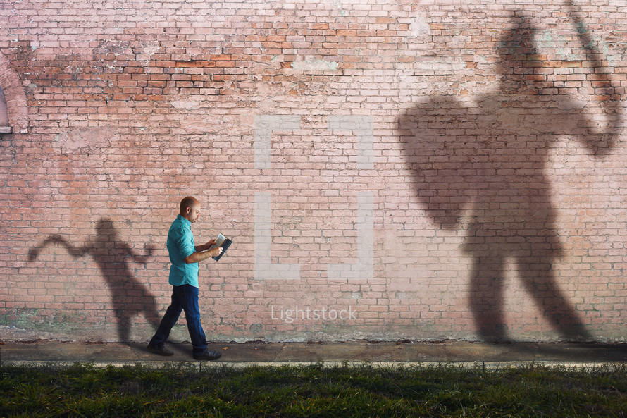 David and Goliath, man reading a Bible as it comes to life